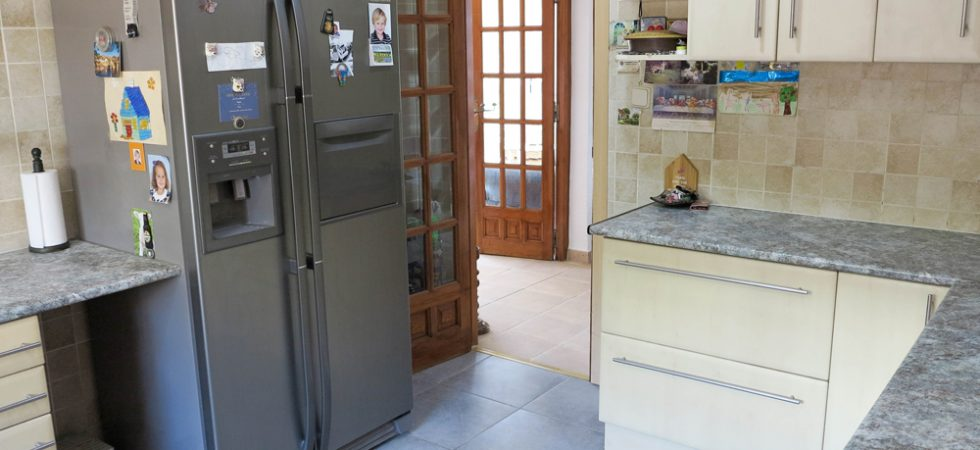 Kitchen With door onto a terraced area